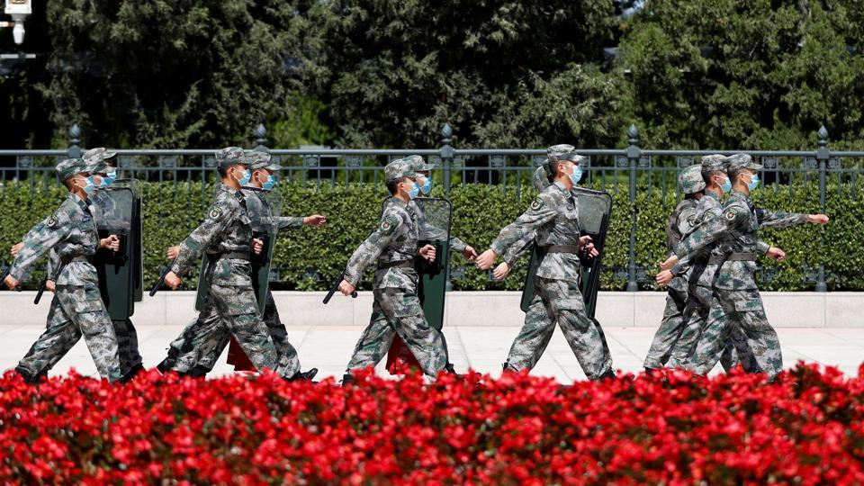 Soldiers of the People's Liberation Army (PLA) march outside the Great Hall of the People in Beijing, China on September 8.