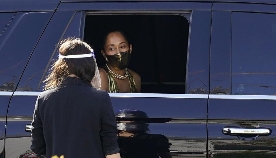 Actress Traces Ellis Ross looks out from her limousine window after receiving a coronavirus test upon her arrival at the 72nd Primetime Emmy Awards at Staples Center, Sunday, Sept. 20, 2020, in Los Angeles.  (Chris Pizzello/Invision/AP)