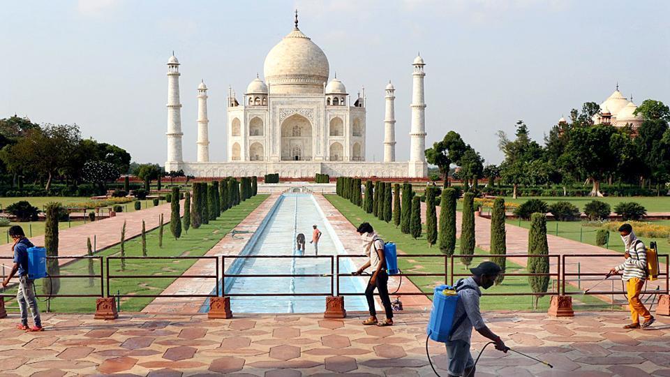 Uttar Pradesh, Sept 20 (ANI): Workers spray disinfection at Taj Mahal premises as Taj Mahal reopens from Sep 21, in Agra on Sunday. (ANI Photo)