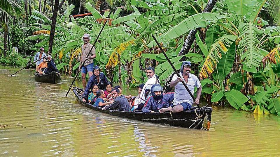 NDRF personnel rescue villagers from Udupi and Dakshina Kannada, in Mangaluru on Sunday.