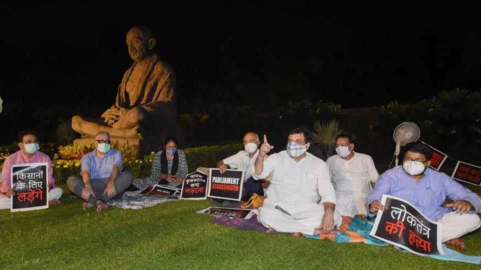 Derek O'Brien of Trinamool Congress and other Opposition members stage a protest over the suspension of eight Rajya Sabha members, farmers' problems and other issues on Monday night.