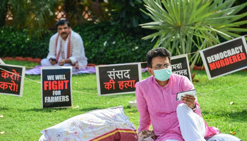 Congress MP Rajiv Satav (R) and AAP MP Sanjay Singh stage a protest over their suspension from the remaining Monsoon Session of Parliament over the ruckus created in Rajya Sabha  (PTI Photo/Kamal Kishore)