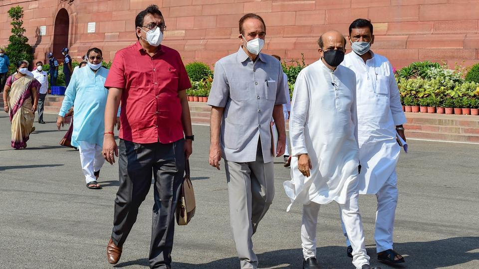 Congress MP Ghulam Nabi Azad, Trinamool Congress MP Dinesh Trivedi and other Opposition MPs stage a walkout from Rajya Sabha, demanding the suspension of eight lawmakers be revoked in New Delhi on Tuesday.