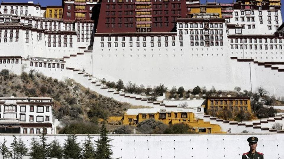 A paramilitary policeman stands guard in front of the Potala Palace in Lhasa, Tibet Autonomous Region, China.