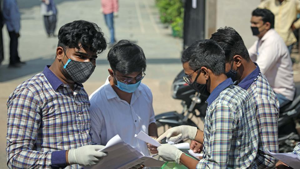 Students of class 10th and 12th wearing protective mask leaves after appearing for compartment examination at an examination centre amidst the outbreak of coronavirus disease, in New Delhi on Tuesday.
