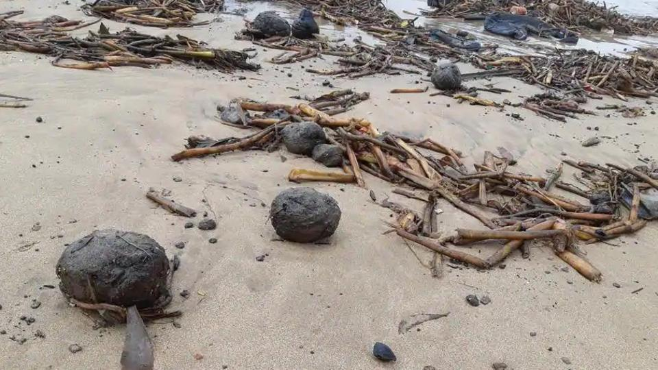The soft and sticky tar balls are a huge deterrent to tourists visiting the beach and threaten the footfalls at beachside businesses. (File Photo)