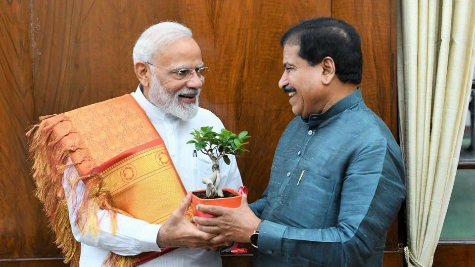 Prime Minister Narendra Modi with Minister of state for railways, Suresh Angadi