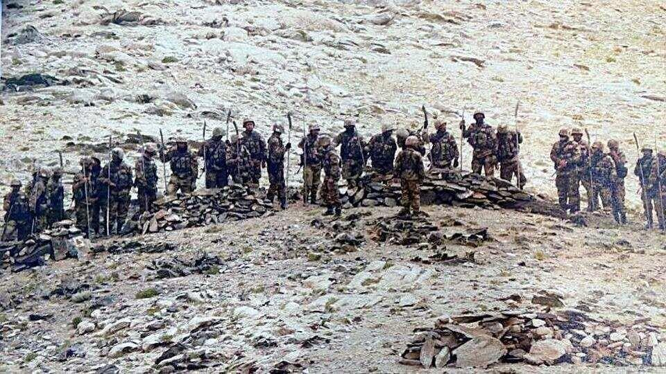In this September 8 file photo, Chinese soldiers armed with stick-machetes during their deployment along the Line of Actual Control in Eastern Ladakh sector.