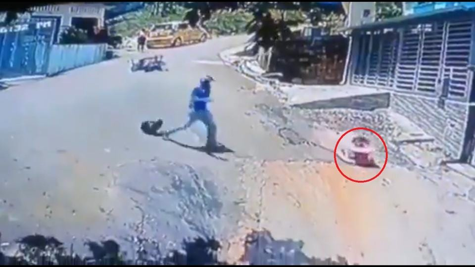 The image shows the man rushing to reach the kid.
