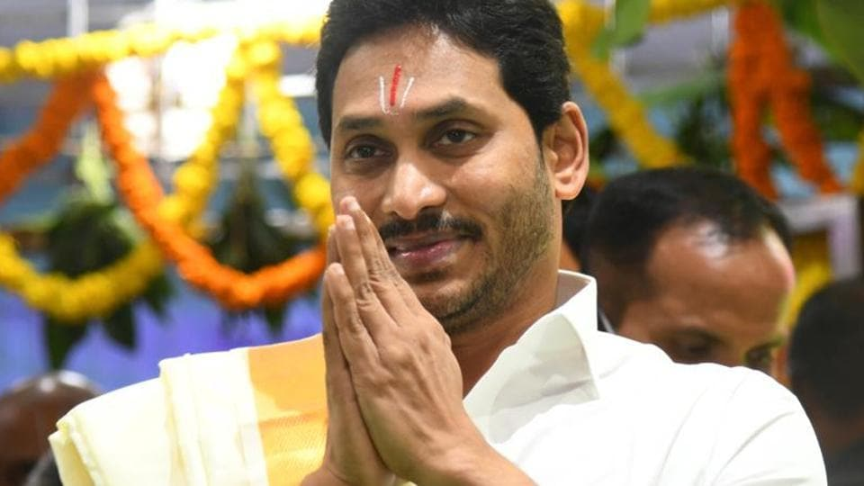 """Jagna Reddy wore traditional attire of a Hindu devotee, sported the """"Thiru Namam"""" (the Vaishnavite style of tilak on the forehead) and carried the silk clothes on his head into the temple to present them to the Lord on behalf of the state government, amidst chanting of Vedic hymns. (HTPhoto )"""
