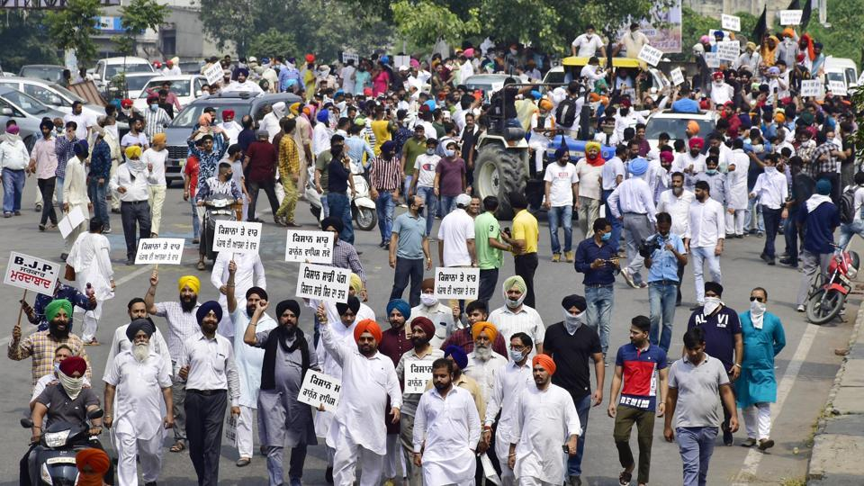 Congress workers march against the farm bills during a protest rally from Bhandari Bridge to Hall gate, in Amritsar, Punjab, India, on Wednesday, September 23, 2020.