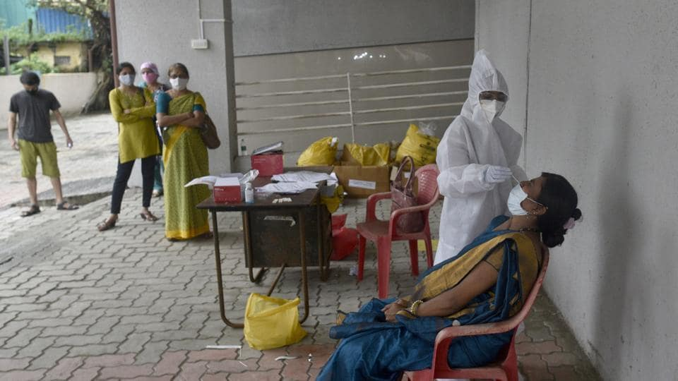 Healthcare workers conduct Covid-19 screening and swab test at Goregaon in Mumbai on Tuesday.
