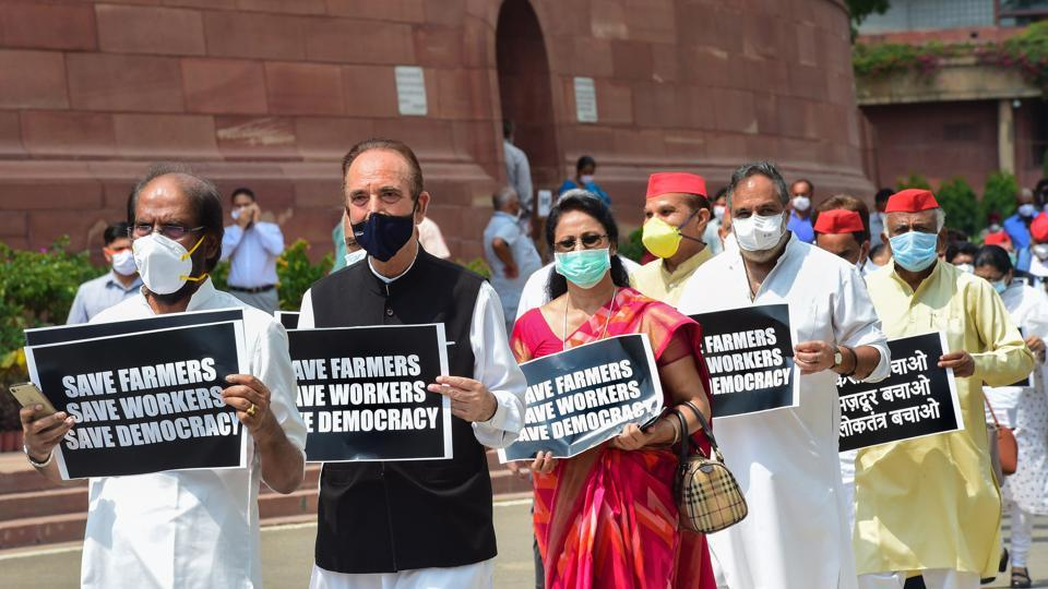 Senior Congress MP Ghulam Nabi Azad and other Opposition lawmakers march from Gandhi statue to Ambedkar statue in protest against the recent farm and labour bills, during the ongoing Monsoon Session, at Parliament House in New Delhi, Wednesday.