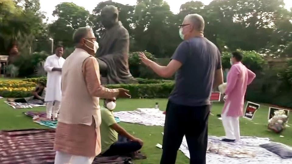Rajya Sabha Deputy Chairman Harivansh meeting Rajya Sabha MPs who were protesting at Gandhi statue against their suspension from the House, over farm bill fracas, on Tuesday. (ANI Photo)