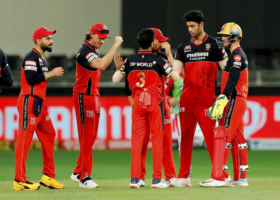 Royal Challengers Bangalore (RCB) players celebrate the wicket of Kings XI Punjab batsman Mayank Agarwal during IPL 2020 cricket match against RCB, at Dubai International Cricket Stadium in Dubai, Thursday, Sept. 24, 2020. (PTI Photo/Sportzpics)(PTI24-09-2020_000199A) (PTI)