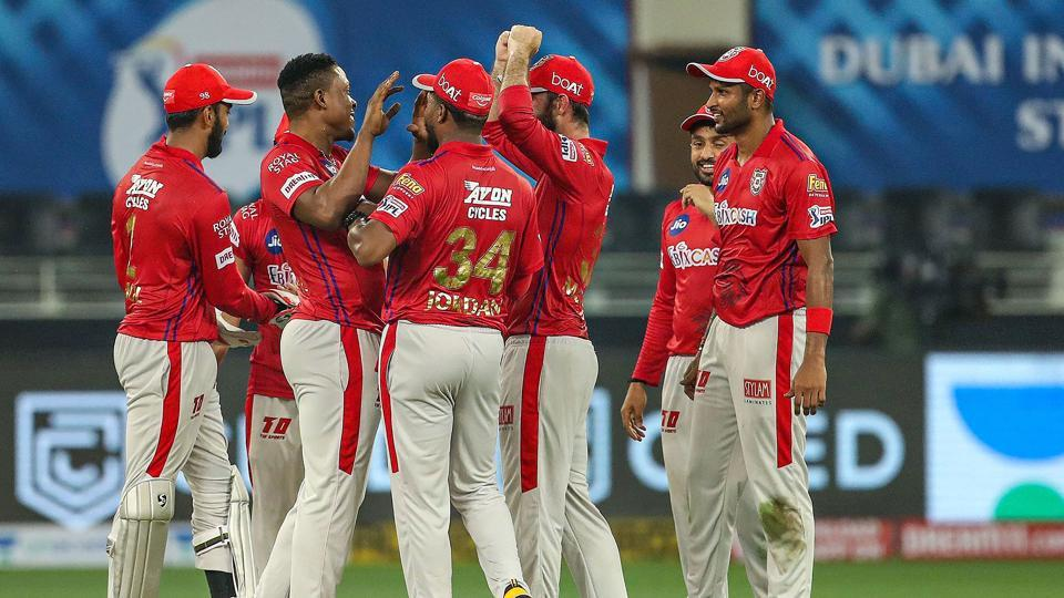Kings XI Punjab players react after the wicket of Delhi Capitals player Axar Patel during the cricket match of IPL 2020, at Dubai International Cricket Stadium.