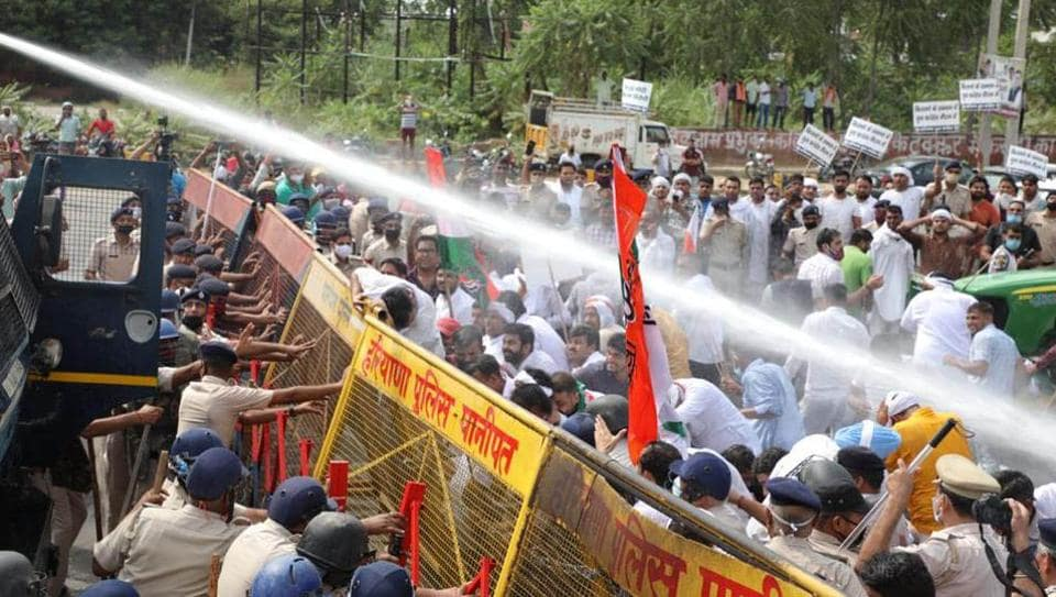 Youth Congress workers protest against the farm bills are dispersed by police using a water canon in Karnal, Haryana on Wednesday.