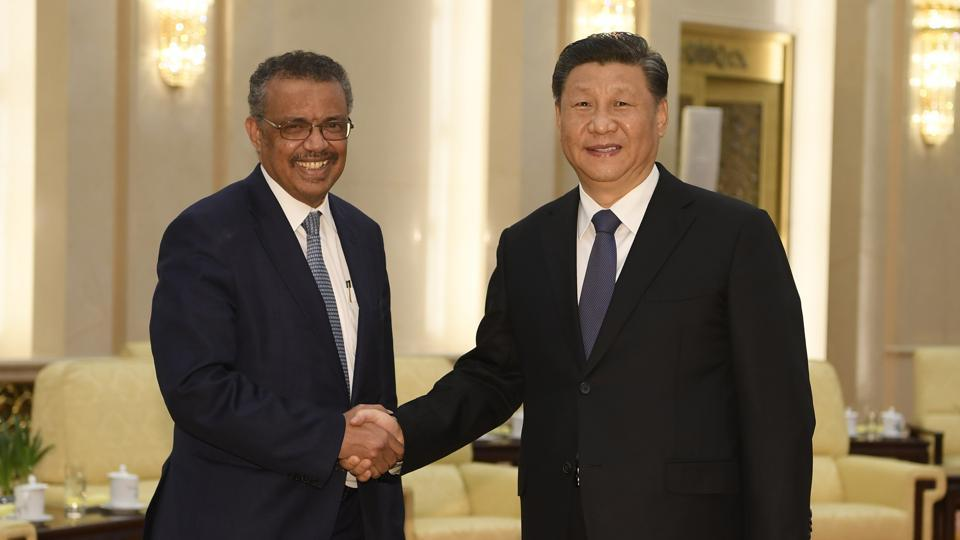 In this file photo, Tedros Adhanom, director general of the World Health Organization shakes hands with Chinese President Xi Jinping before a meeting at the Great Hall of the People in Beijing on January 28 2020