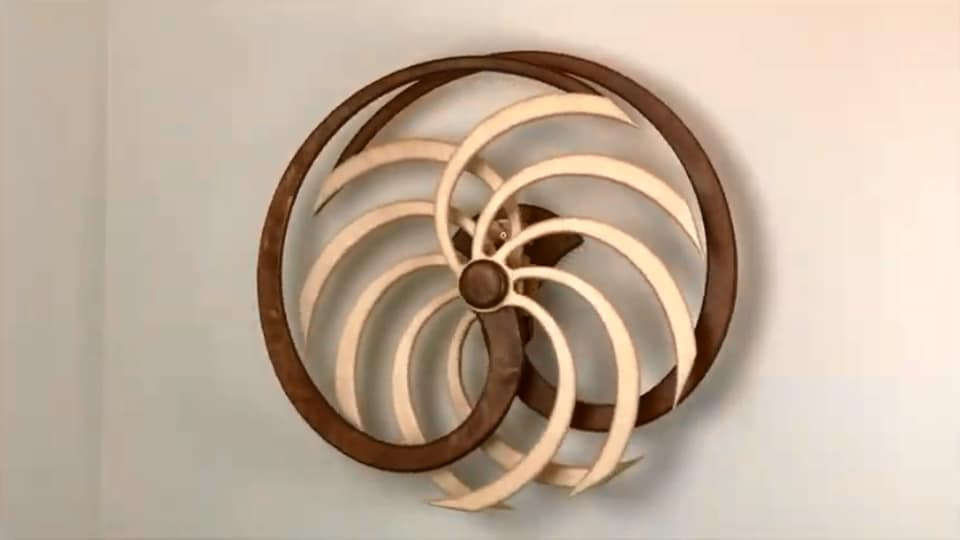 The image shows the kinetic sculpture in question.