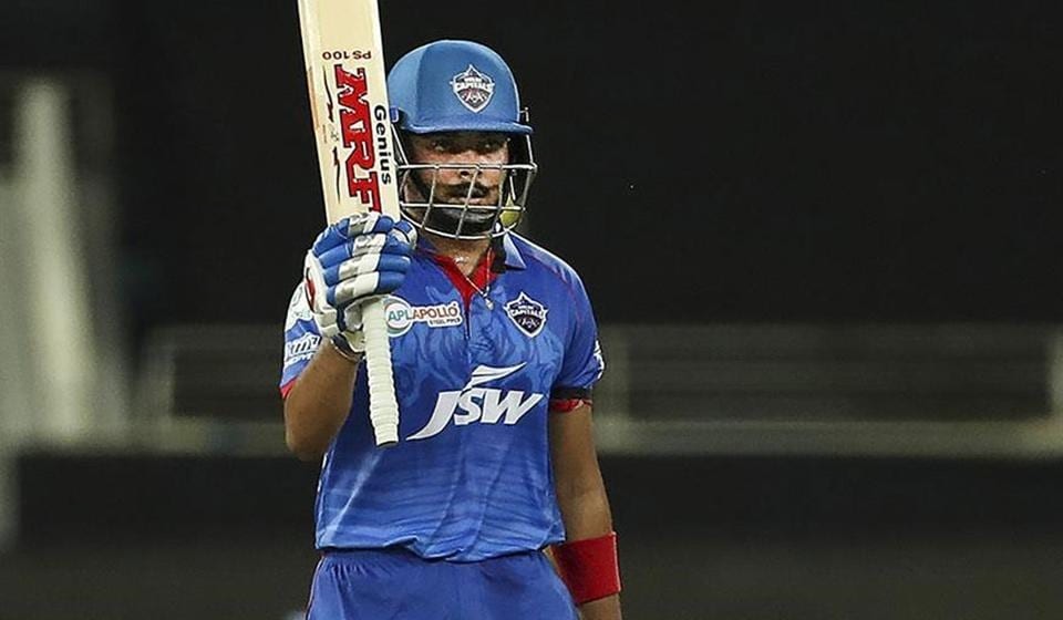 Prithvi Shaw raises his bat after getting to his fifty.