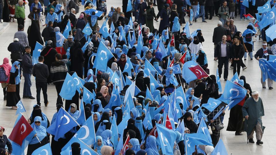 In this file photo from November 6, 2018, people from the Uighur community living in Turkey carry flags of what ethnic Uighurs call 'East Turkestan', during a protest in Istanbul, against what they allege is oppression by the Chinese government to Muslim Uighurs in far-western Xinjiang province.