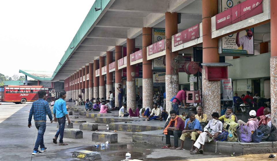Passengers waiting for transport to resume at the Ludhiana bus stand on Friday.