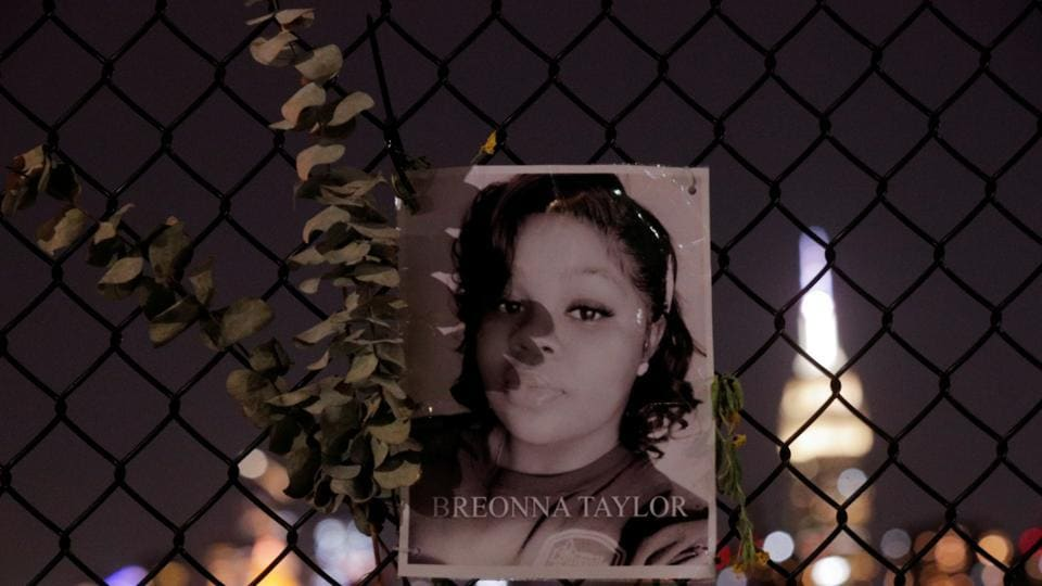 A picture of Breonna Taylor is seen at a makeshift memorial for victims of racial injustice, following the announcement of a single indictment in Taylor's case, in the Brooklyn borough of New York City, New York, US.