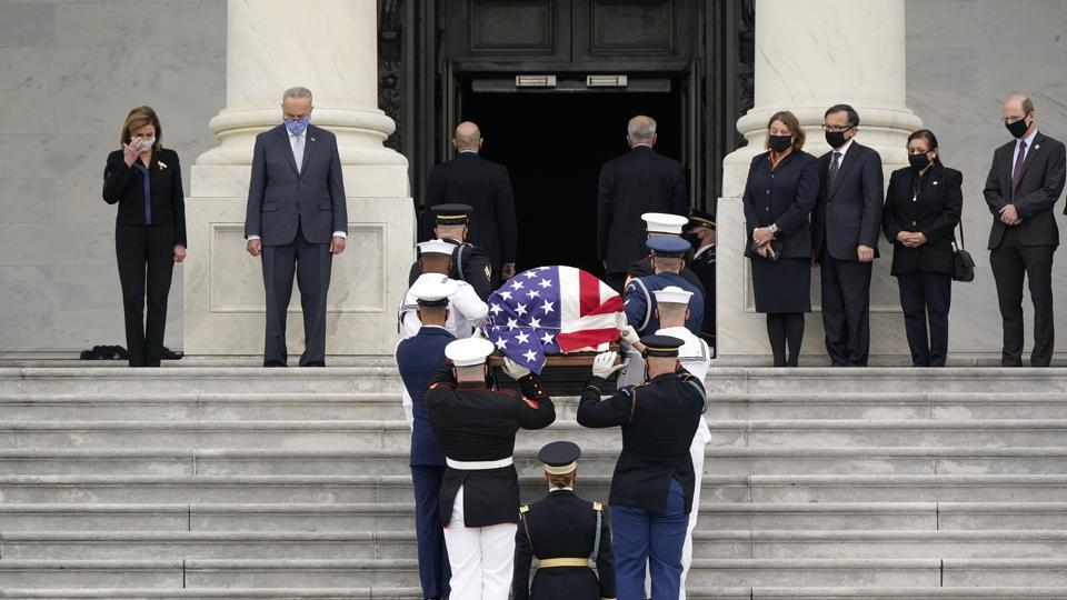 The flag-draped casket of Justice Ruth Bader Ginsburg is carried by a joint services military honor guard to lie in state at the US Capitol, Friday, Sept. 25, 2020, in Washington.