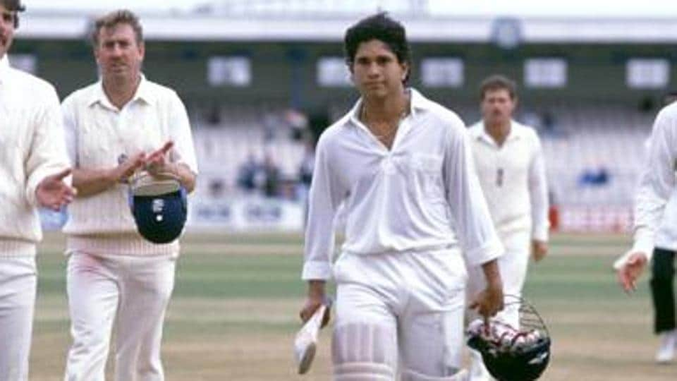 A young-Sachin is applauded by England players as he walks off the field after a Test match.