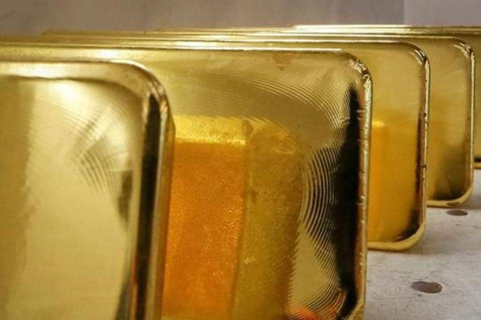 Gold ingots are seen in this file photo. Between Monday to Thursday morning, gold has become cheaper by Rs 1,810. At the same time, the silver price has fallen by Rs 9,655 per kg.