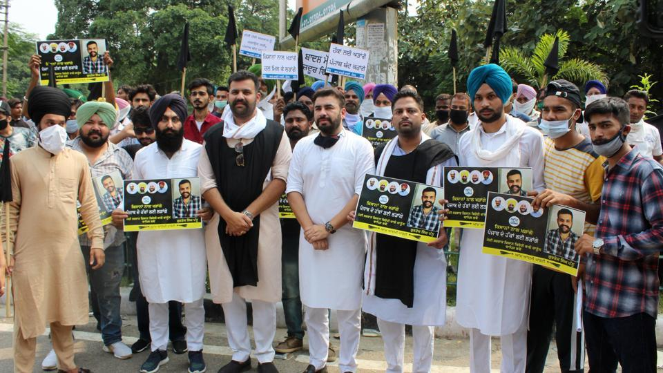 AAP activists staging a protest in Mohali on Thursday.