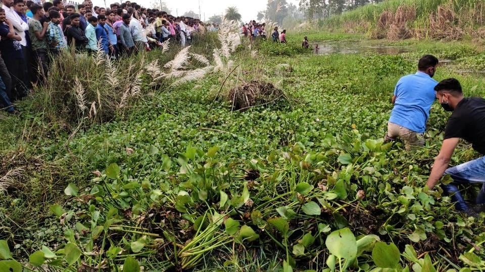 Forest officials, police and locals searching for the girl, who was attacked by a crocodile, in Haridwar forest division.