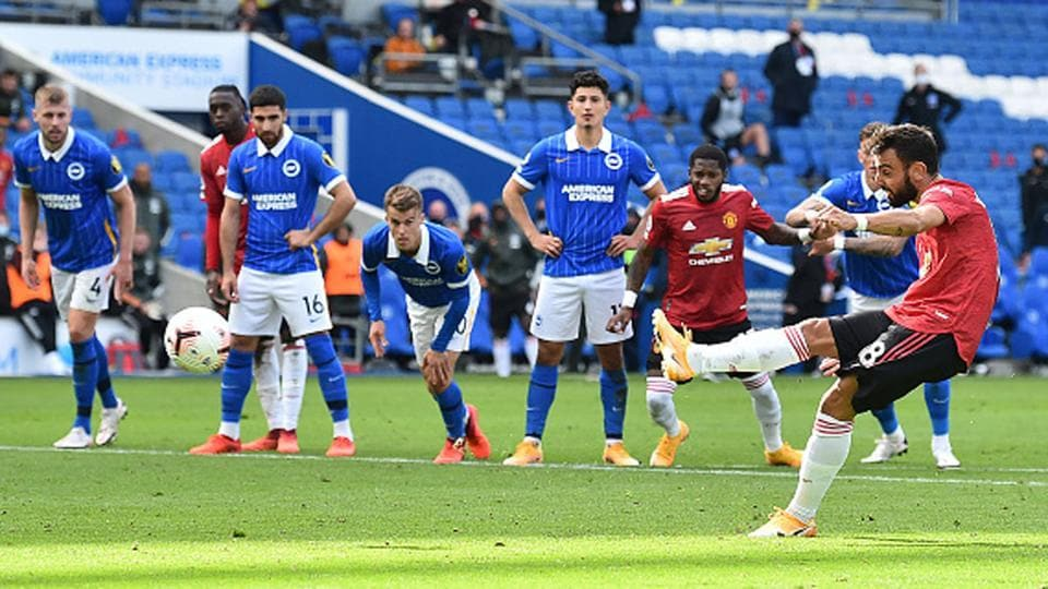 Manchester United's Bruno Fernandes scores his side's third goal of the game from the penalty.