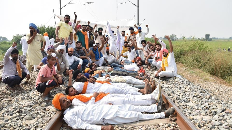 Farmers raise slogans while occupying a railway track during 'rail roko' protest at Devi Dasspura village, in Amritsar, Punjab.
