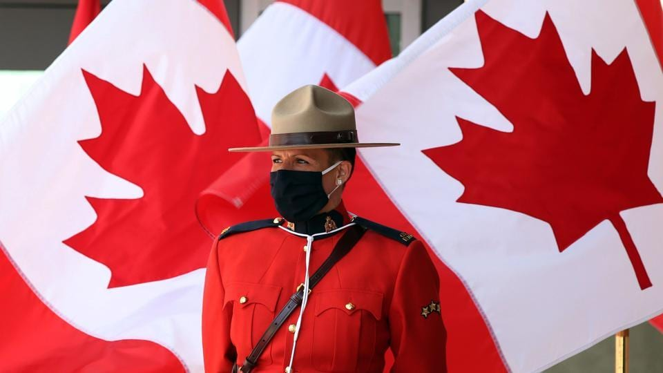 A Royal Canadian Mounted Police officer stands guard outside the Senate of Canada prior to the Speech from the Throne on September 23 in Ottawa, Canada.