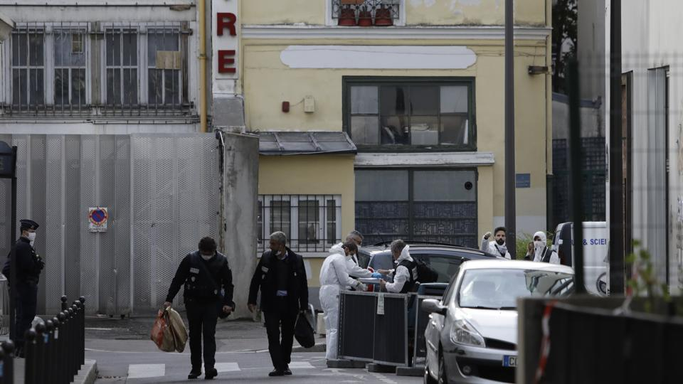 Police officers leave the scene after a knife attack near the former offices of satirical newspaper Charlie Hebdo, Friday Sept. 25, 2020 in Paris. French terrorism authorities are investigating a stabbing of two people Friday outside the former offices of the satirical newspaper Charlie Hebdo in Paris, and two suspects have been arrested, authorities said.