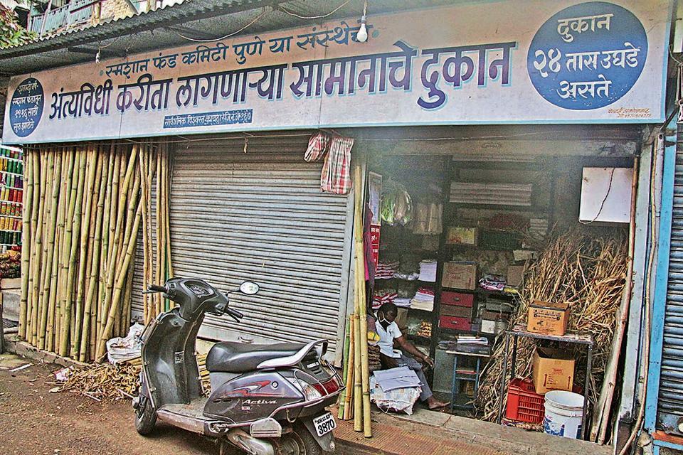 A shops selling kits for final rites wears a deserted look at Mahatma Phule Mandai.