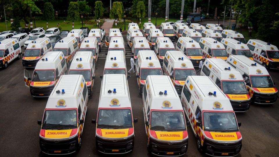A man walks past ambulances parked at the city Council hall in Pune on September 25, 2020. In a first of its kind initiative in the country, village councils of Pune have pooled underutilised health fund money to purchase 92 ambulances and firm up the rural health infrastructure amid the rise in COVID-19 cases. Each ambulance is equipped with two portable oxygen cylinders of 2.2 litre capacity, Global Positioning System, auto-loading stretcher facility and storage space for first aid and nursing kits. in Pune, India, on Friday, September 25, 2020.