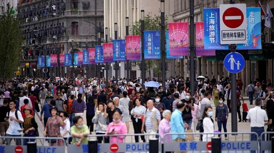 People visit a main shopping area following the coronavirus disease (Covid-19) outbreak in Shanghai, China on September 24, 2020.