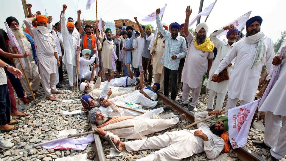 Farmers shout slogans as they block a railway track during a protest against farm bills passed by Parliament, in Devi Dasspura village on the outskirts of Amritsar in Punjab on September 24.