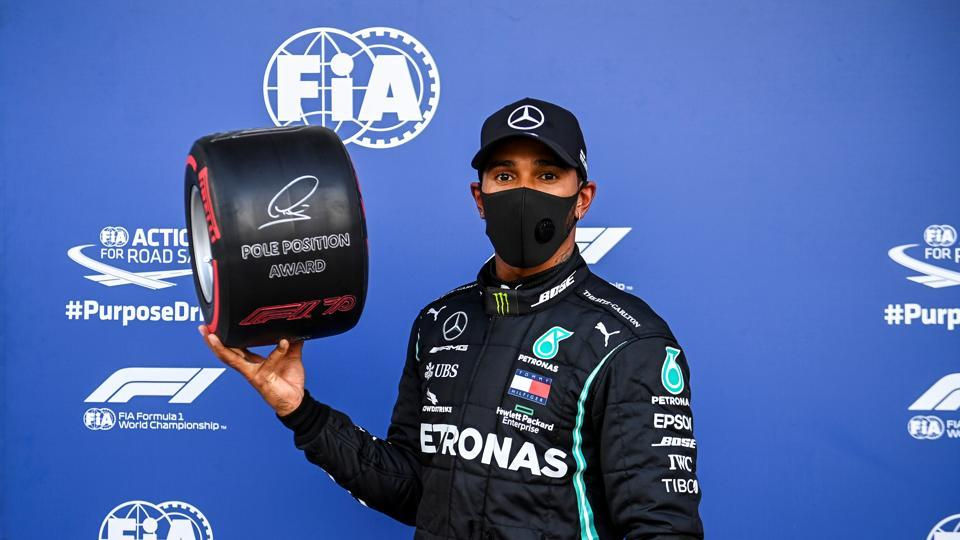 Formula One F1 - Russian Grand Prix - Sochi Autodrom, Sochi, Russia - September 26, 2020 Mercedes' Lewis Hamilton celebrates with the Pirelli Pole Position Award after qualifying in pole position.