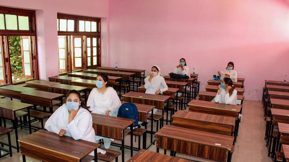 Students attending a class at a school in Srinagar on September 21.