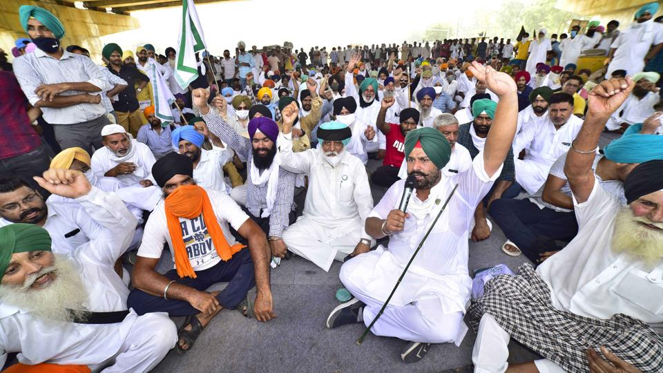 Farmers unions protesting near Ladhowal toll plaza in Ludhiana on Friday.