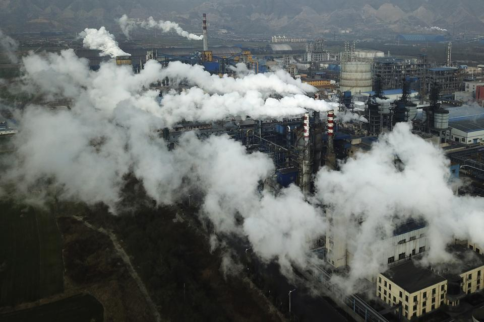 Smoke and steam rise from a coal processing plant in Hejin in central China's Shanxi Province. Chinese President Xi Jinping says his country will aim to stop pumping additional carbon dioxide, the main global warming gas, into the atmosphere by 2060.