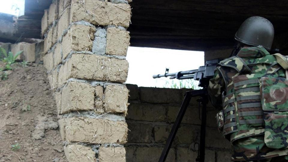 An Azeri serviceman aims his weapon at the frontline with the self-defence army of Nagorno-Karabakh in Azerbaijan.