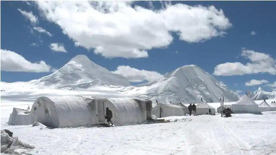 In this picture, Indian Army personnel set up camp at an unknown location in Siachen Glacier.