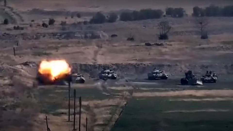 An image grab taken from a video made available on the official web site of the Armenian Defence Ministry on September 27, 2020, allegedly shows destroying of Azeri military vehicles during clashes between Armenian separatists and Azerbaijan in the breakaway region of Nagorno-Karabakh.