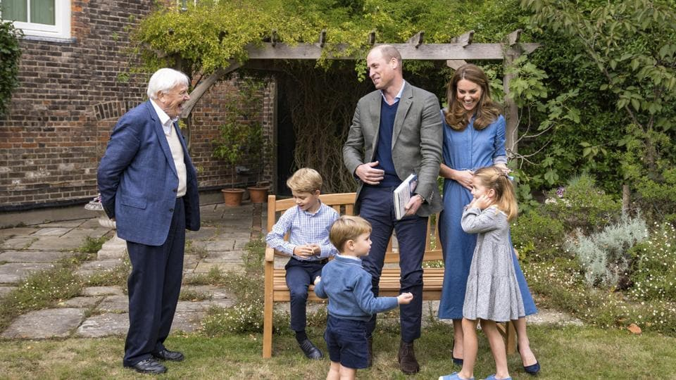 The photo shows members of royal family with Naturalist David Attenborough.
