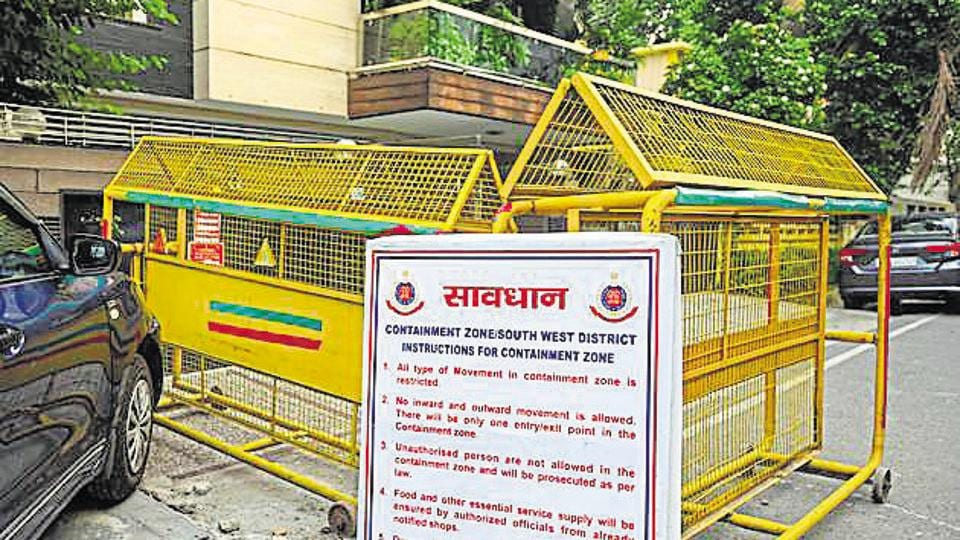 Barricades seen outside a containment zone at Green Park Extension in New Delhi on Thursday