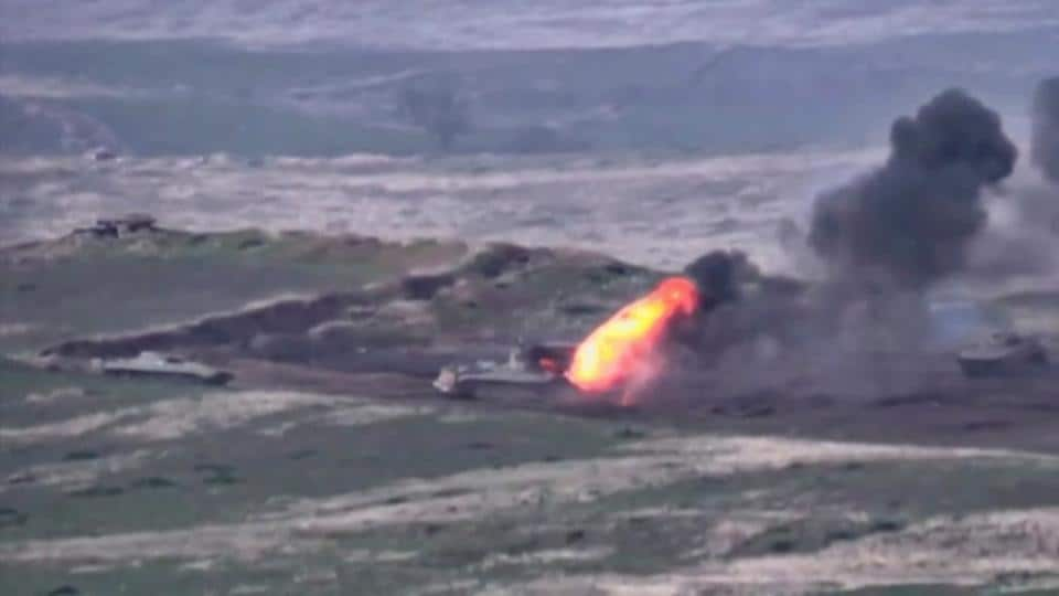 A still image from a video released by the Armenian Defence Ministry shows what is said to be Azerbaijani armoured vehicles, one of which is destroyed by Armenian armed forces in the breakaway region of Nagorno-Karabakh.